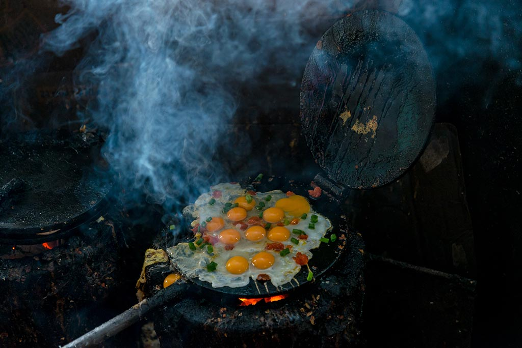Pressed cakes with fried eggs