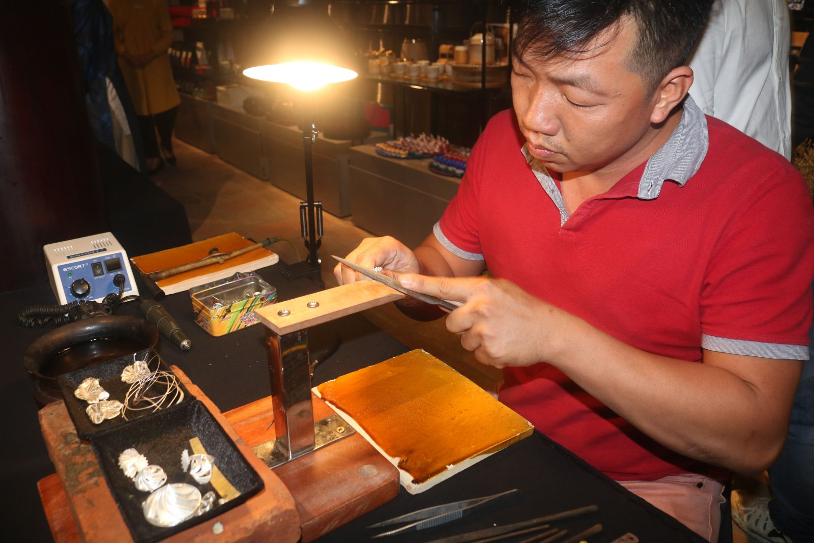 An artisan demonstrating the jewelry making process