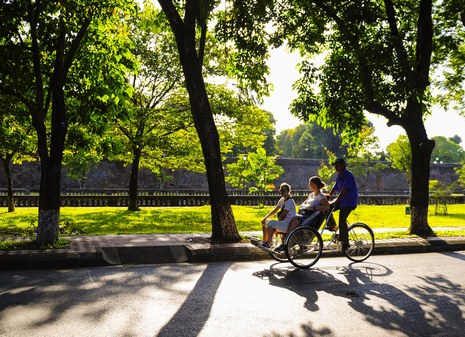Foreign tourists on Hue's cyclos, admiring the autumn sun