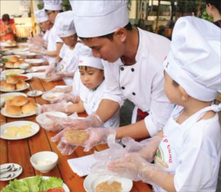 Children enjoying kitchen experience