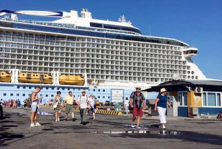 Cruise ship Ovation of the Seas docks at Chan May port