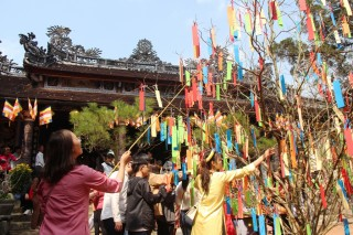 Visiting Buddhist pagodas on the first day of the Lunar New Year