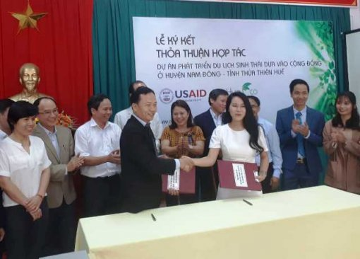 Signing a project to support community-based ecotourism development in Nam Dong