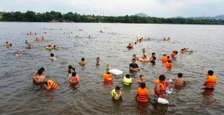 Swimming in Huong river on summer