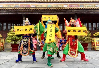 Tourists eager to see the royal dance on the second day of Tet