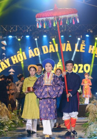 Despite the rain, Hue is still lively with ao dai and cuisine