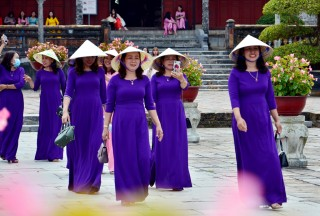 Dressing in ao dai and visiting heritages on International Women's Day